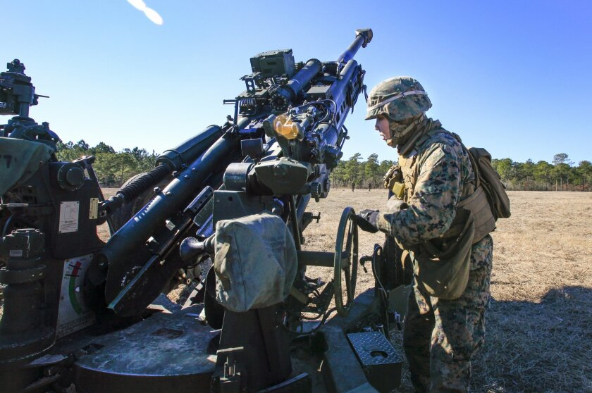 Sgt. Mindy Vuong, a cannoneer on an artillery battery at Camp Lejeune in North Carolina, is part of the Marine Corps' Ground Combat Element Integrated Task Force. / photo by Howard Lipin * U-T San Diego