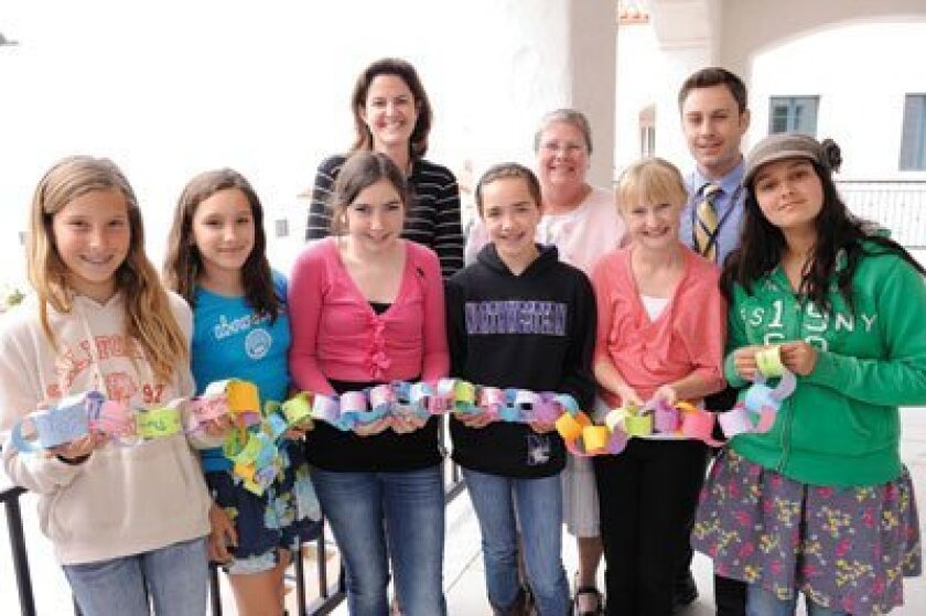 R. Roger Rowe students and staff: (Above) Front: Savannah Denney, Allie Wilson, Nicole Stein, Mariella Gauvreau, Sarah Lackey, Kay Jensen; Back: Principal Kim Pinkerton, Superintendent Lindy Delaney, Paul Coco. Photo/Jon Clark