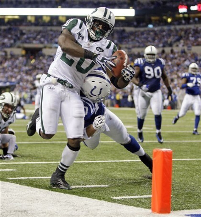 FILE - In this Dec. 27, 2009, file photo, New York Jets running back Thomas Jones, left, is pushed out of bounds by Indianapolis Colts cornerback Jamie Silva during an NFL football game in Indianapolis. The Kansas City Chiefs have signed free agent running back Jones, who led the Jets to the AFC championship game last season and was the NFL's third-leading rusher. (AP Photo/Michael Conroy, File)