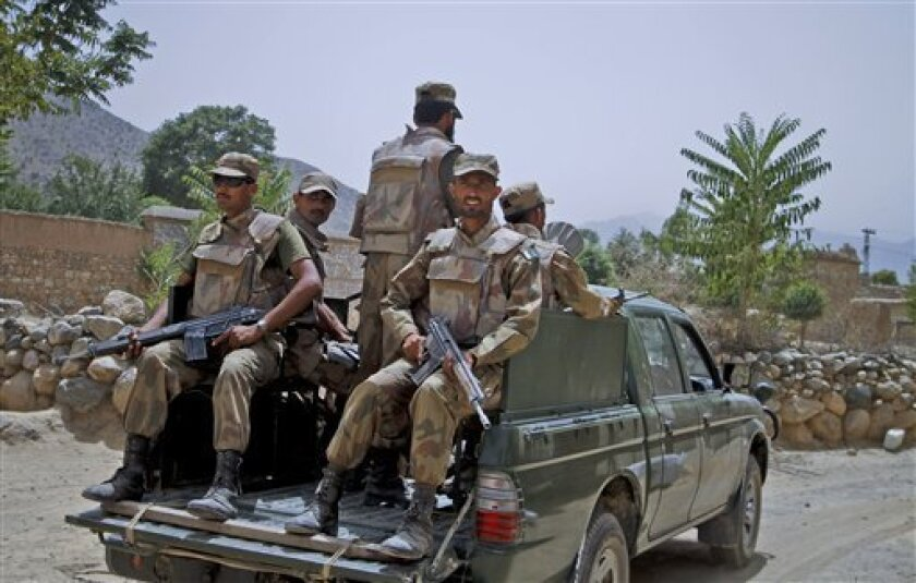 Pakistani army troops patrol in Jhanda, in Pakistan's Mohmand tribal region along the Afghan border, Wednesday, June 1, 2011. A top Pakistani army commander said that the military has no imminent plans to launch an offensive in the North Waziristan tribal region, home to numerous militants who focus on attacking U.S. and NATO forces in neighboring Afghanistan. (AP Photo/Anjum Naveed)