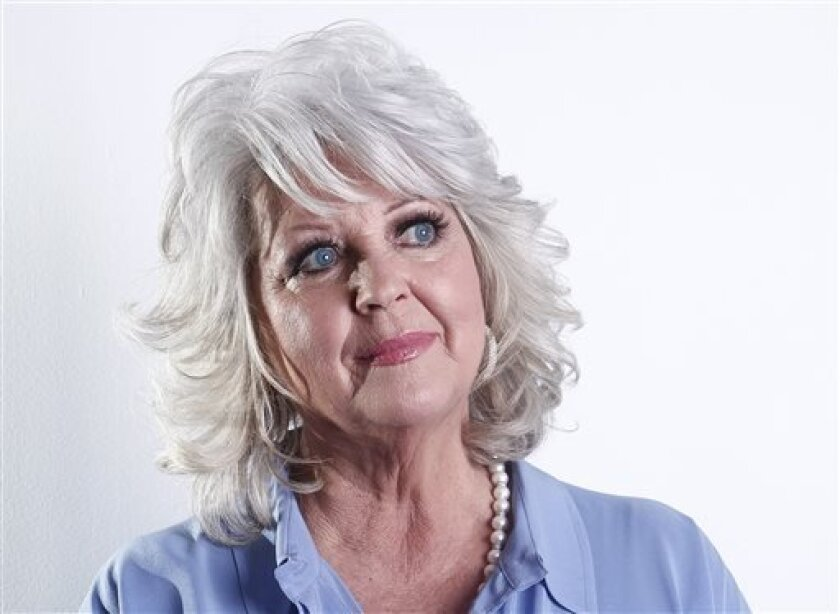 FILE - In this Jan. 17, 2012 file photo, celebrity chef Paula Deen poses for a portrait in New York. Deen announced Thursday, July 4, 2013 that she has cut business ties with the agent who helped make her a Food Network star and launch a media and merchandising empire that has largely crumbled in the wake of her admission that she used racial slurs in the past. She gave no reason for her parting with Weiner in a prepared statement. (AP Photo/Carlo Allegri, File)