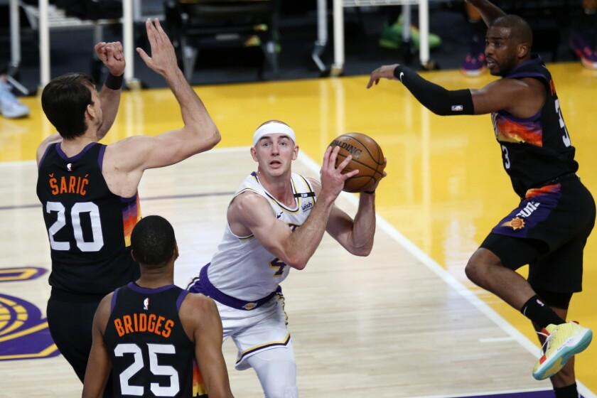 Lakers guard Alex Caruso draws the Suns defense toward him on a drive into the lane.