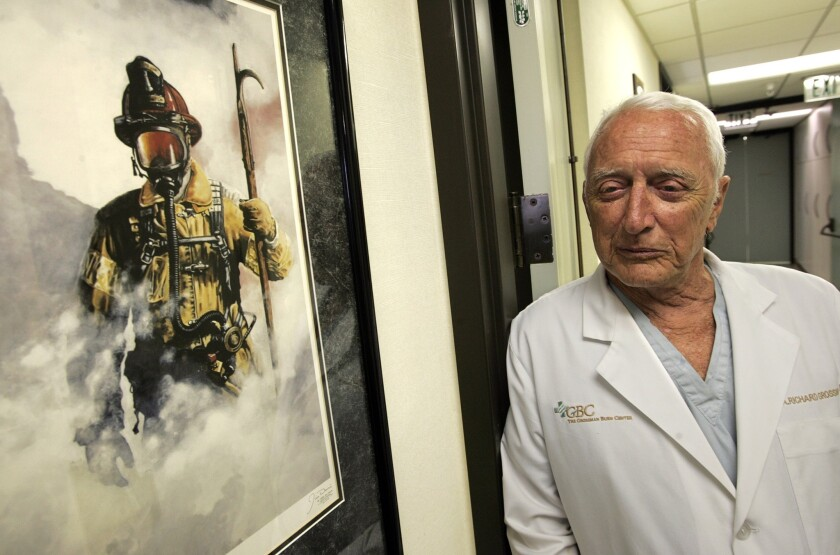 Dr. A. Richard Grossman, founder and co-medical director of the Grossman Burn Center in Sherman Oaks, is photographed in the hallway of his office in 2009.