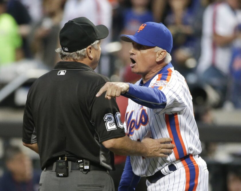 New York Mets manager Terry Collins (10) argues with umpire Tom Hallion after being ejected during the third inning of a baseball game against the Los Angeles Dodgers, Saturday, May 28, 2016, in New York. (AP Photo/Frank Franklin II)