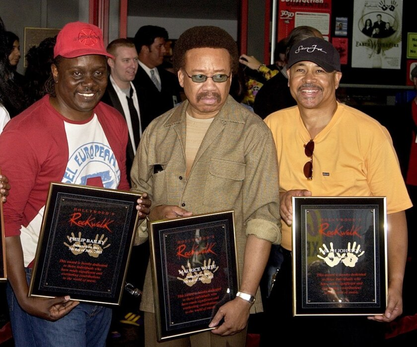 FILE - In this July 7, 2003 file photo, Philip Bailey, from left, Maurice White, and Ralph Johnson, of Earth Wind & Fire hold up the plaques from their induction at the Hollywood Rock Walk at a ceremony in Los Angeles. White, the founder and leader of Earth, Wind & Fire, died at home in Los Angeles