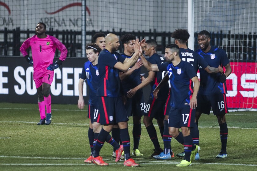 U.S. players celebrate their fourth goal during the international friendly against Jamaica on March 25.