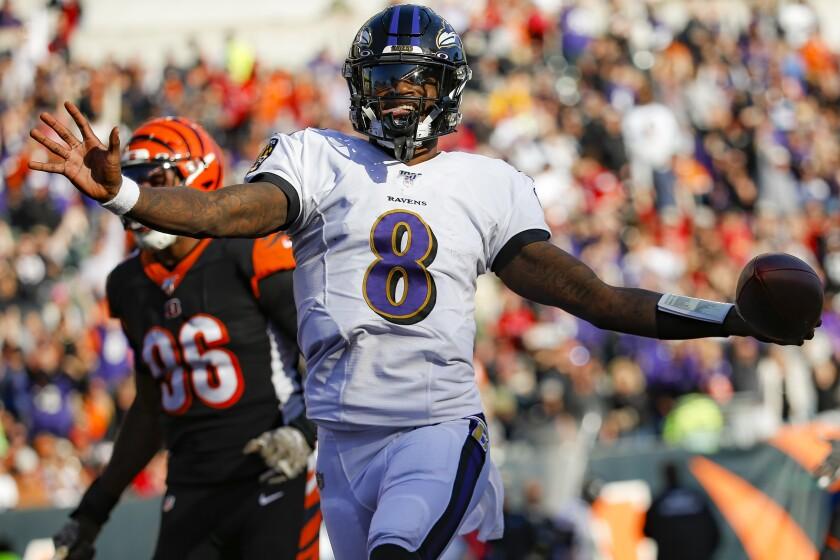 Baltimore Ravens quarterback Lamar Jackson (8) celebrates his touchdown during the second half of NFL football game against the Cincinnati Bengals, Sunday, Nov. 10, 2019, in Cincinnati. (AP Photo/Frank Victores)