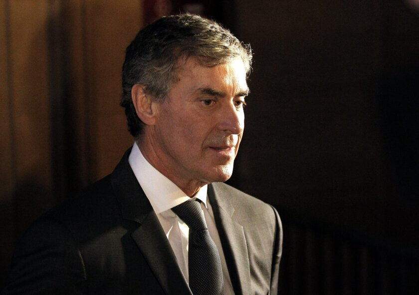 Former French budget minister Jerome Cahuzac leaves the Paris court, Monday, Feb.8, 2016. Cahuzac appears in court on charges of tax fraud and money laundering that forced him to dramatically resign three years ago in the first political scandal under President Francois Hollande. (AP Photo/Christop