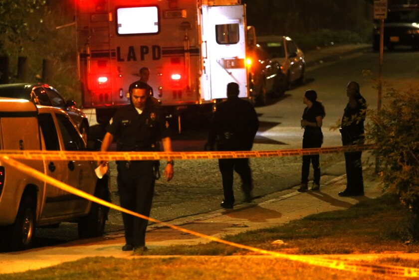 For the first time in more than a decade, all categories of crime rose across Los Angeles in 2015. Above, police investigate a double-homicide in in Montecito Heights in October.
