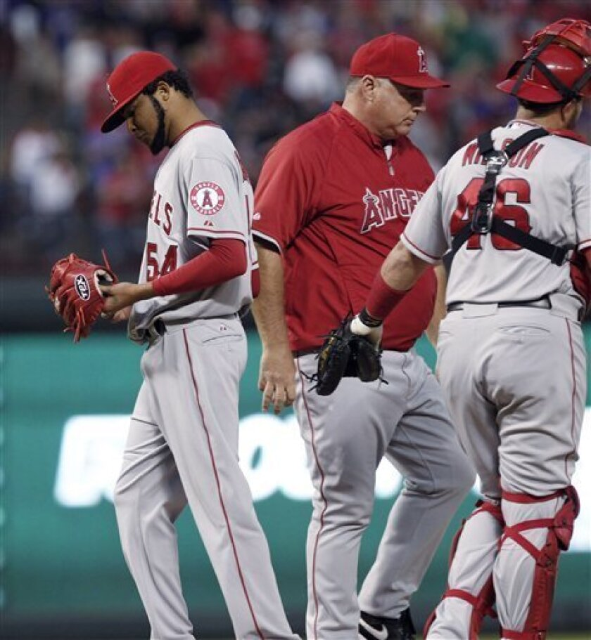 Los Angeles Angels starting pitcher Ervin Santana (54) is pulled from the game by manager Mike Sioscia, with catcher Bobby Wilson nearby during the third inning of the second baseball game of the Angels' doubleheader against the Texas Rangers, Sunday, Sept. 30, 2012, in Arlington, Texas. The Rangers won 8-7. (AP Photo/LM Otero)