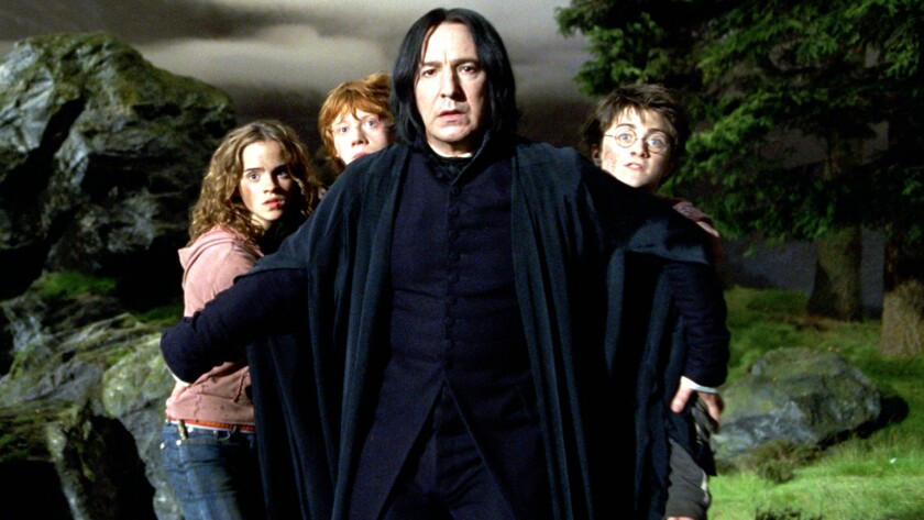 "Alan Rickman, center, with Emma Watson, left, Rupert Grint and Daniel Radcliffe in ""Harry Potter and the Prisoner of Azkaban,"" released in 2004."