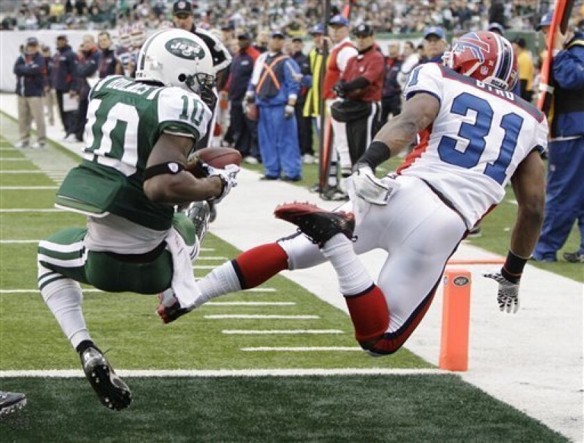 New York Jets' Santonio Holmes, left, catches a pass for a touchdown while covered by Buffalo Bills' Jairus Byrd during the second quarter of an NFL football game at New Meadowlands Stadium, Sunday, Jan. 2, 2011, in East Rutherford, N.J. (AP Photo/Kathy Willens)