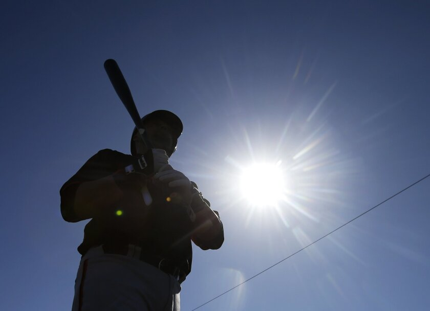 San Francisco Giants' Casey McGehee waits to hit during spring training baseball practice Friday, Feb. 27, 2015, in Scottsdale, Ariz. (AP Photo/Darron Cummings)