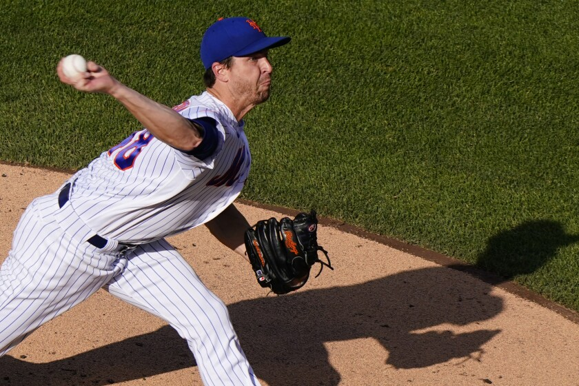 New York Mets starting pitcher Jacob deGrom winds up during the second inning of a baseball game against the Atlanta Braves, Monday, June 21, 2021, in New York. (AP Photo/Kathy Willens)