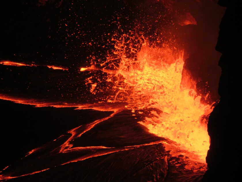 """Spattering from what's called the """"lava lake"""" at the summit of Kilauea on June 29."""