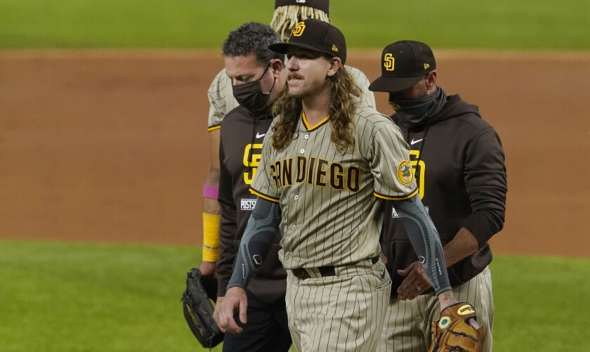 San Diego Padres starting pitcher Mike Clevinger leaves Game 1 of the NLDS on Tuesday.