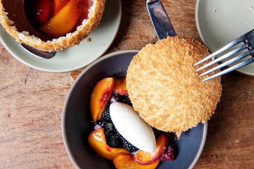 """En Croute"" dessert, with peaches and blackberries spooned around lemon verbena ice cream"