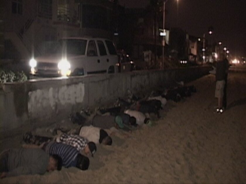 At least 20 suspected illegal immigrants were detained when their boat came ashore in Mission Beach  early Monday.
