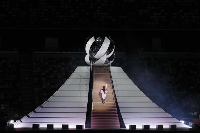 Actors perform during the opening ceremony at the Olympic Stadium