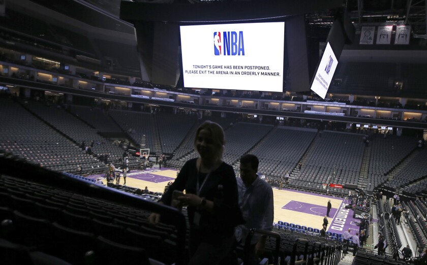 Fans leave the Golden 1 Center after the NBA basketball game between the Pelicans and Kings was postponed at the last minute in Sacramento on March 11.