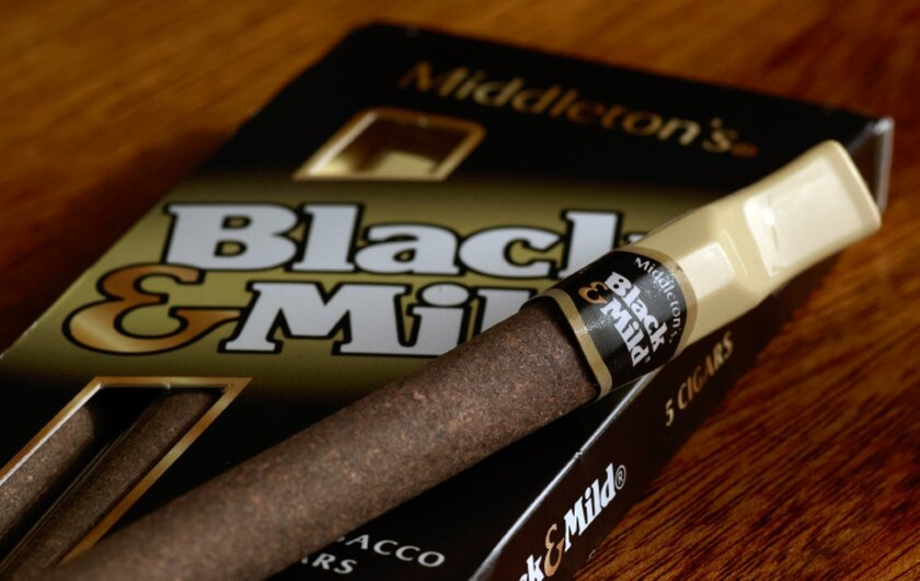 """This undated product image provided by Altria shows John Middleton Co.'s Black & Mild cigars. Under a Food and Drug Administration proposal to regulate cigars and other tobacco products the same as cigarettes, cigar makers would have to remove descriptions like """"light,"""" ''mild,"""" ''medium"""" or """"low"""""""