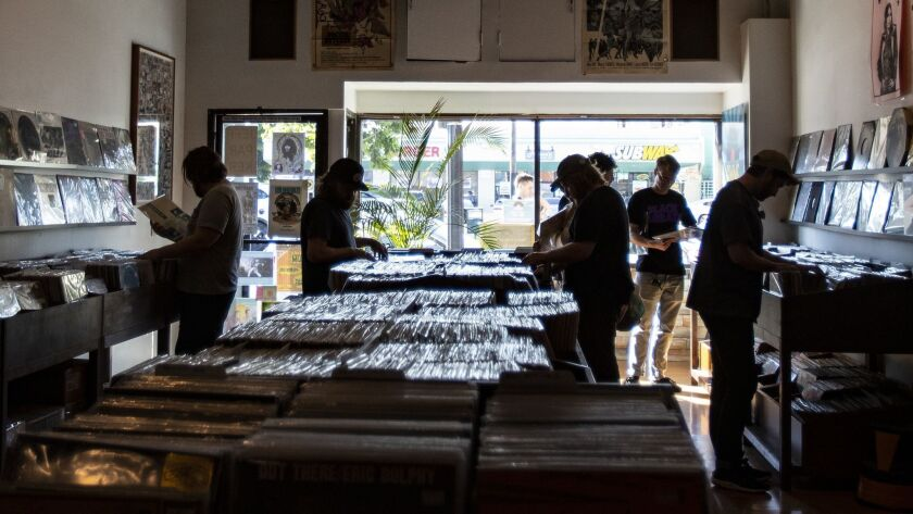 HIGHLAND PARK, CA - JUNE 8, 2019: Customers browse for albums at Gimme Gimme Records located on nort
