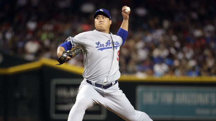 Los Angeles Dodgers starting pitcher Hyun-Jin Ryu throws to an Arizona Diamondbacks batter during th