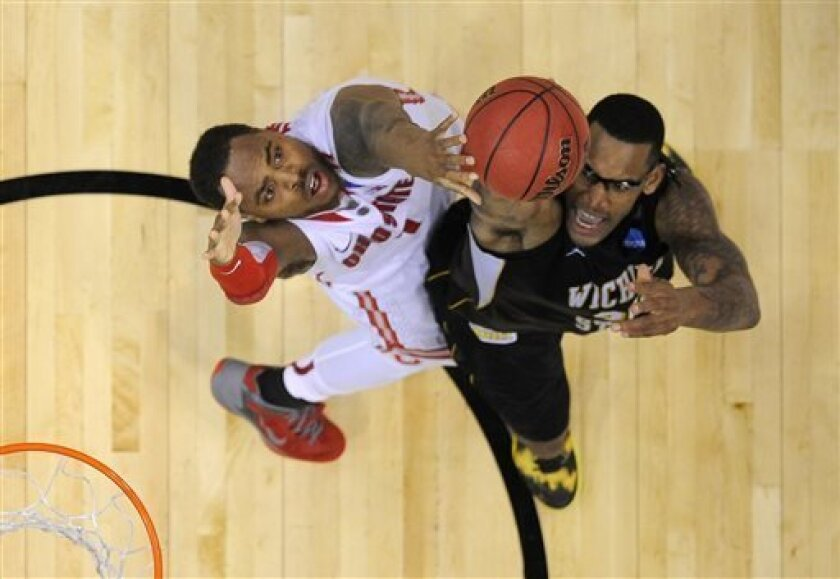 Wichita State forward Carl Hall, right, puts up a shot as Ohio State forward Deshaun Thomas defends during the first half of the West Regional final in the NCAA men's college basketball tournament, Saturday, March 30, 2013, in Los Angeles. (AP Photo/Mark J. Terrill)