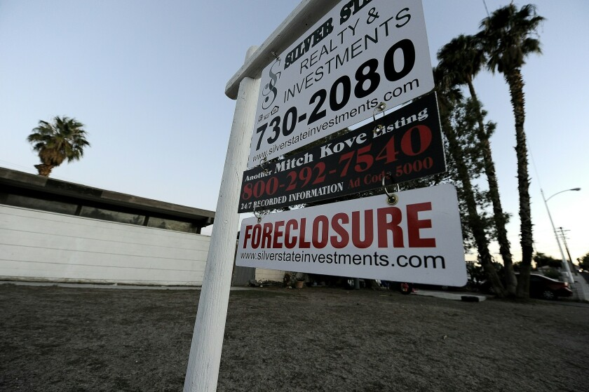 A foreclosure sign stands in front of a bank-–owned home in Las Vegas in 2010.