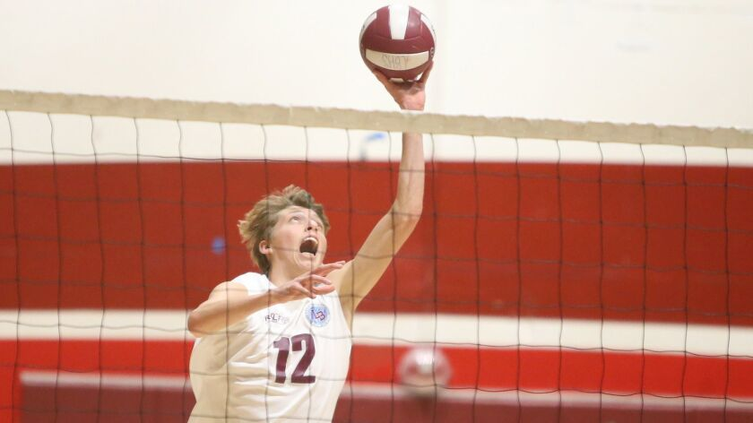 Laguna Beach High's Geste Bianchi tips the ball over the net during Sunset Conference crossover, vol