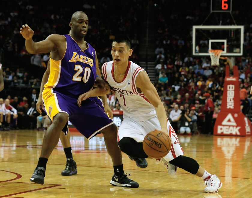Houston Rockets point guard Jeremy Lin, right, drives against Lakers guard Jodie Meeks during the first half of Wednesday's game.
