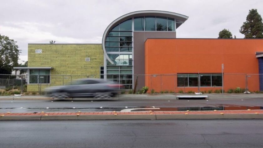 A car drives by the new library at 810 Imperial Beach Boulevard.