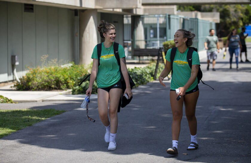 Volleyball players Dallas Smulson, left, and Kate Griffin walk through the Golden West College campus on Monday, August 30.