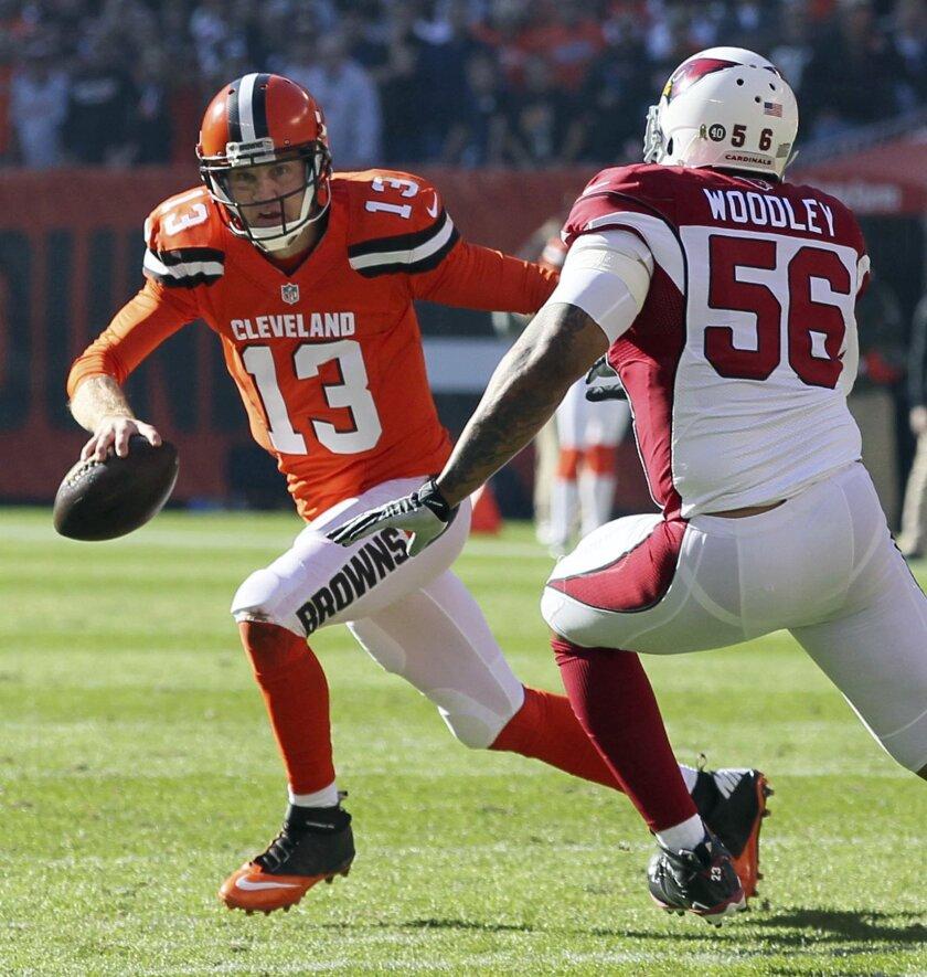 Cleveland Browns quarterback Josh McCown, left, scrambles away from Arizona Cardinals linebacker LaMarr Woodley during an NFL football game Sunday, Nov. 1, 2015, in Cleveland. (Ed Suba Jr./Akron Beacon Journal via AP)  MANDATORY CREDIT