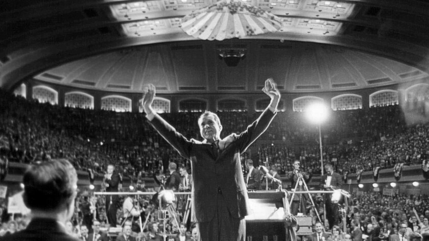 Then-Republican presidential nominee and Vice President Richard M. Nixon acknowledges cheers during a campaign speech at Public Hall in Cleveland on Oct. 6, 1960.