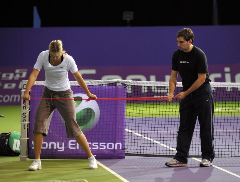 Juan Reque (right) works with tennis star Maria Sharapova on the ATP tour.