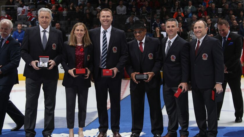 Hall of Fame inductees Aleksander Yakushev, Jayna Hefford, Martin Brodeur, Willie O'Ree, Martin St. Louis and Gary Bettman are introduced prior to the 2018 Hockey Hall of Fame Legends Classic Game at the Air Canada Centre.