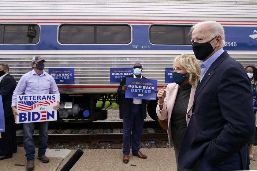 Democratic presidential candidate Joe Biden and Jill Biden before boarding a train