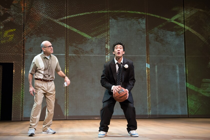 "James Eckhouse as the coach, Justin Chien as the free-throw-sinking player in ""The Great Leap."""