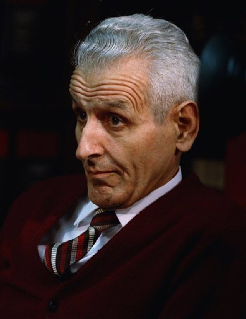FILE - In this Dec. 3, 1990 file photo, Dr. Jack Kevorkian sits in his lawyer's office in Southfield, Mich., after Oakland County Prosecutor Richard Thompson announced that he would be charged with murder in the death of a woman who committed suicide by using a device of the doctor's. Kevorkian's lawyer and friend, Mayer Morganroth, says the assisted suicide advocate died Friday, June 3, 2011 at a Detroit-area hospital at the age of 83. (AP Photo, File)