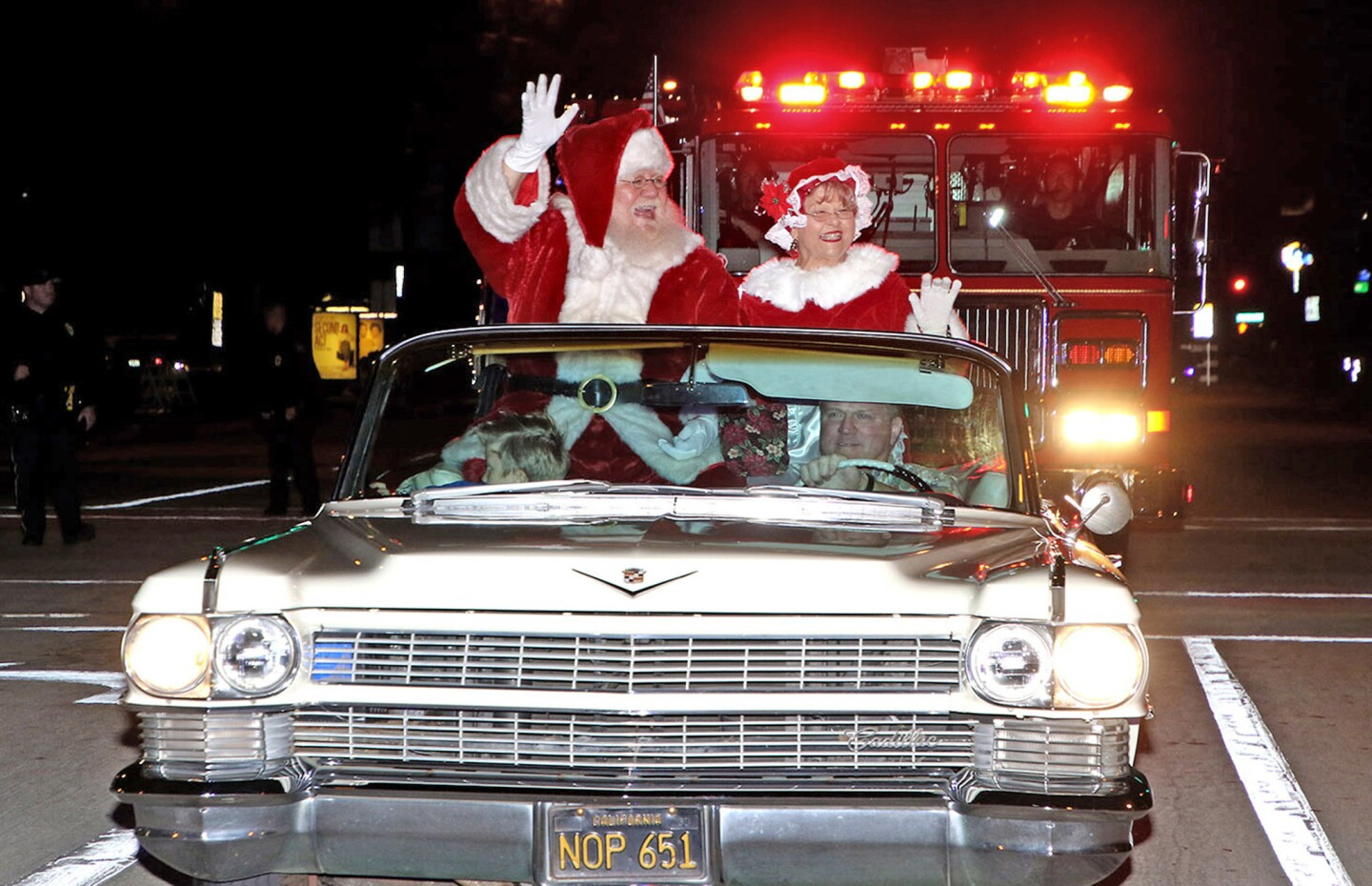 Santa and Mrs Claus arrive at Burbank City Hall via a classic Cadillac driven by Richard Bertain Jr. (Photo by Ross A Benson)