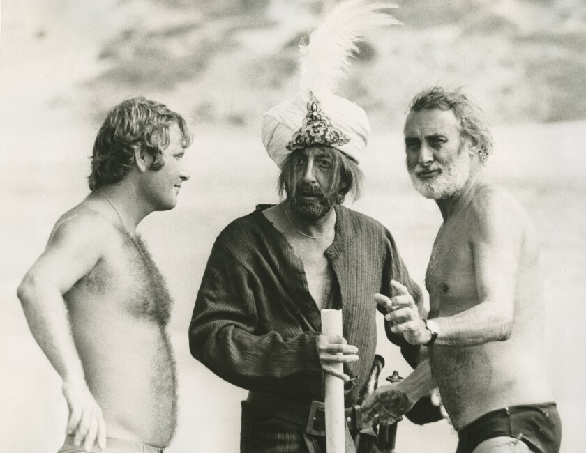 "Peter Medak, Peter Sellers and Spike Milligan on the set of ""Ghost in the Noonday Sun."""