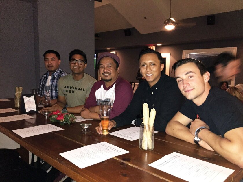 Edwin Real (center) formed the Facebook group Eating and Drinking in San Diego. He's pictured during an event at the San Diego Beer Project with friends (from left) chef Tony Guan, brewer Derek Gallanosa, chef Phillip Esteban and bartender Brandon Curry.