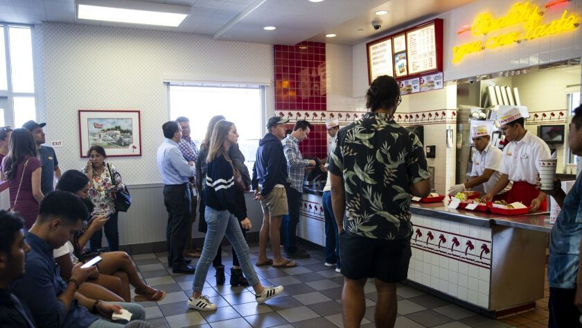 LOS ANGELES, HI - AUGUST 30: People pack the In-N-Out Burger for the lunch rush, on Thursday, Aug. 3