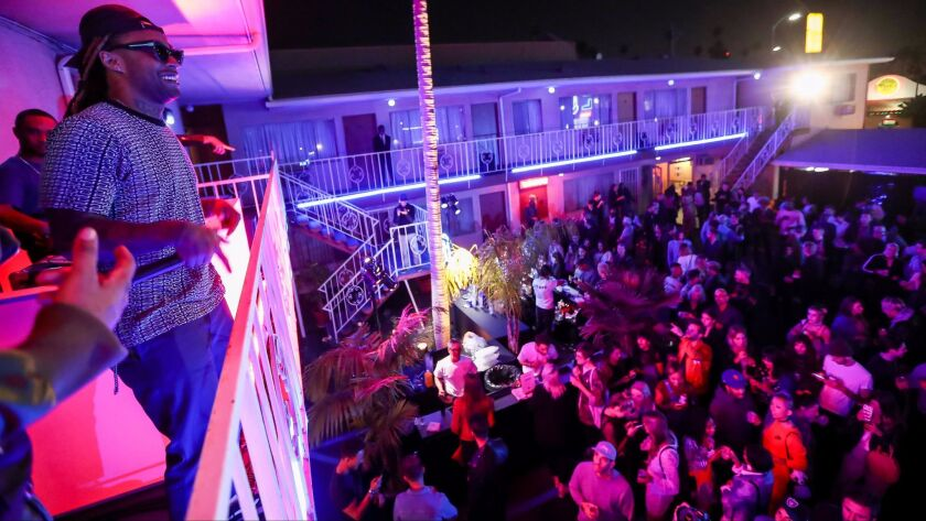 Ty Dolla Sign on the balcony of the Hollywood Premiere Motel on April 19 during luxury online retailer Mr Porter's celebration of its Made in California collection.