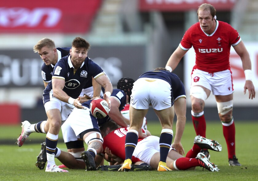 Scotland's Ali Price, left, releases the ball during the Six Nations rugby match against Wales, at Parc y Scarlets, in Llanelli, Wales, Saturday Oct. 31, 2020. (David Davies/PA via AP)