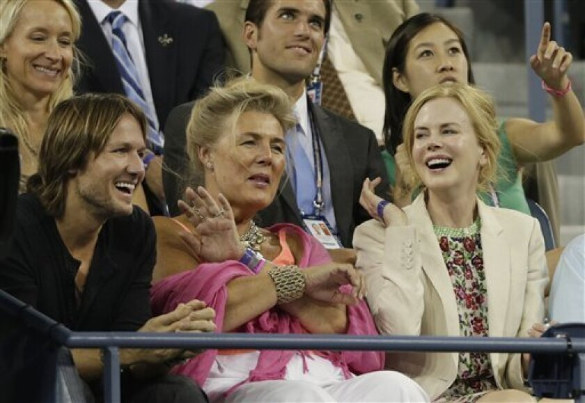 Keith Urban, far left, and Nicole Kidman, far right, watch a match between Andy Roddick and Australia's Bernard Tomic in the third round of play at the 2012 US Open tennis tournament,  Friday, Aug. 31, 2012, in New York. (AP Photo/Charles Krupa)