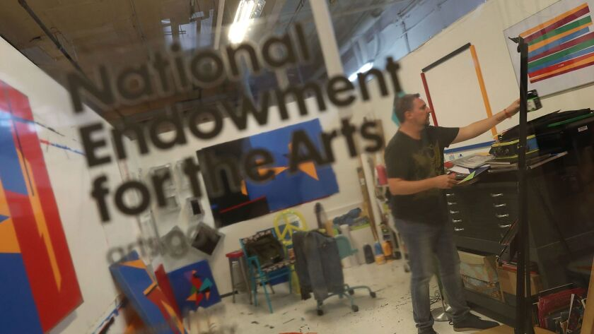 An artist works at the Bakehouse Art Complex in Miami. Cuts to the NEA could mean the loss of federal funding for art spaces such as this.