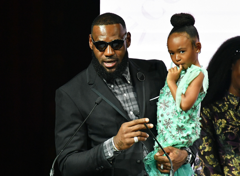LeBron James hold his daughter, Zhuri, during a news conference at New York Fashion Week in September 2018.