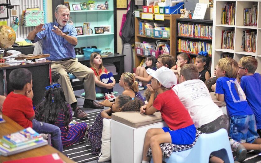 Veteran Robert Shaw speaks to a second-grade class at Mariners Elementary School in Newport Beach on Thursday.